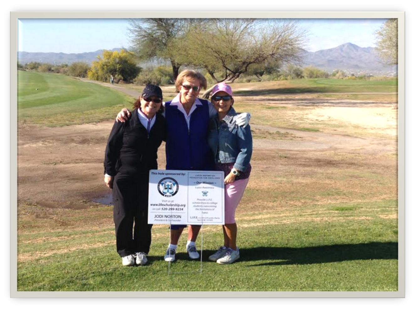 Three ladies participating in the Diva's Golf Tournament