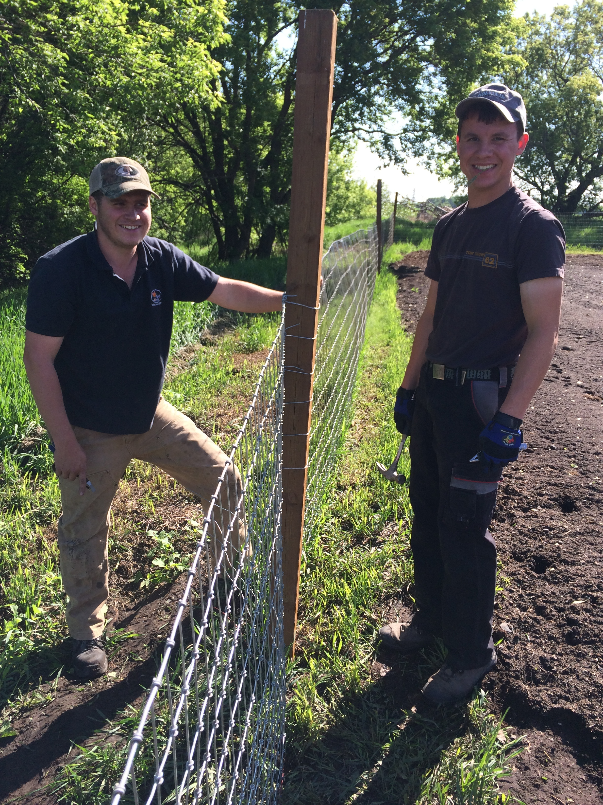 Trainees working on the deer fence