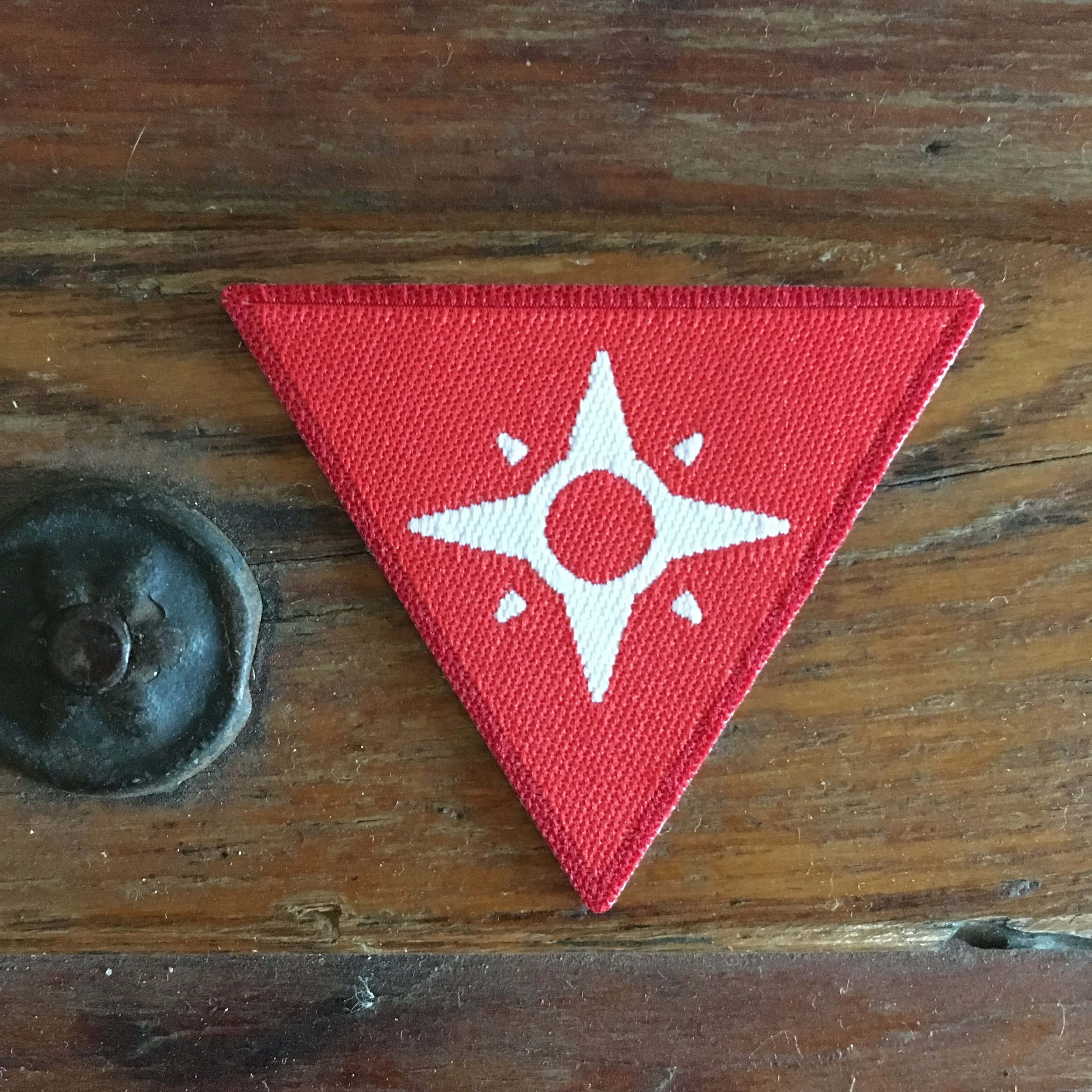 Redshirt's Badge - Redshirts exemplify the core ideals of the Explorers Guild. Members earn this badge by showing up and showcasing elements of community building, story creation, skill development and a willingness to leave their comfort zone.Start your journey with this badge.