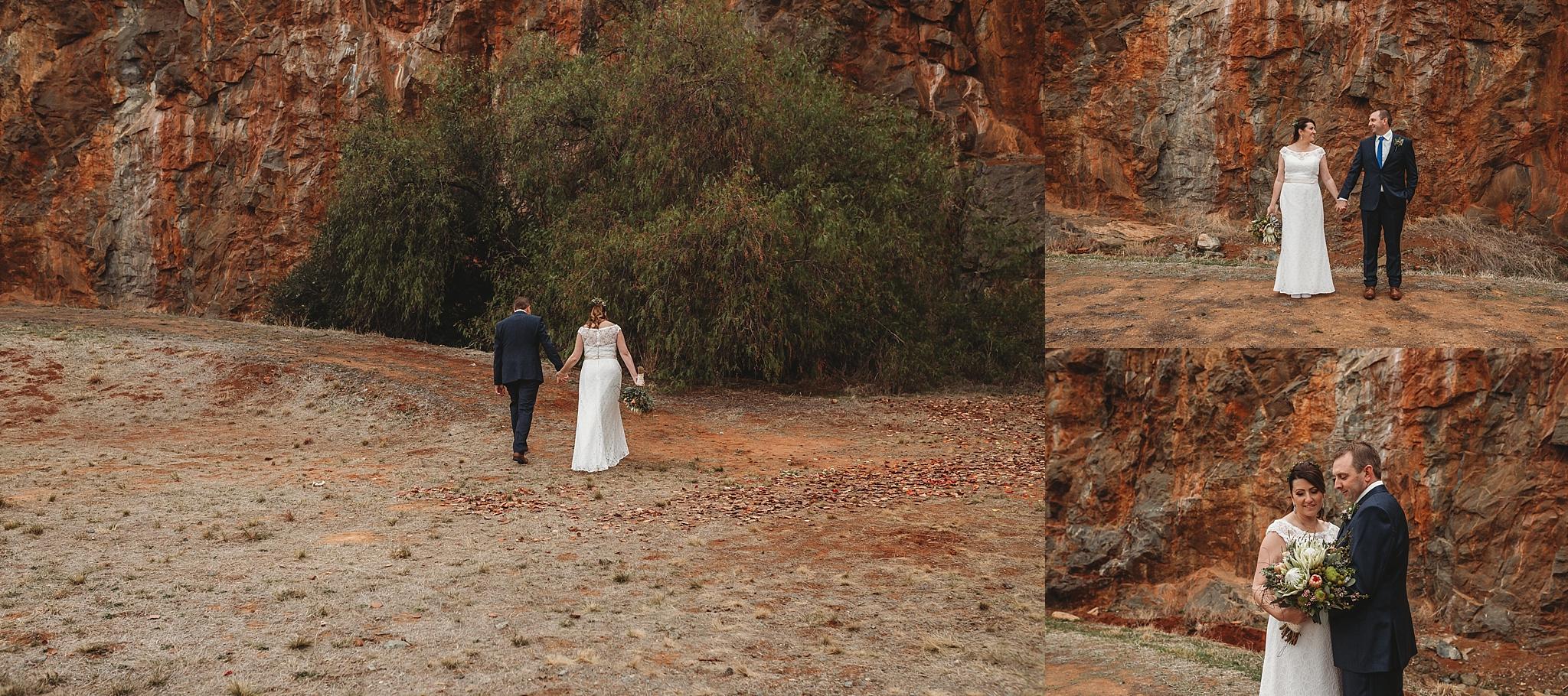 bride and groom walking in dookie quarry