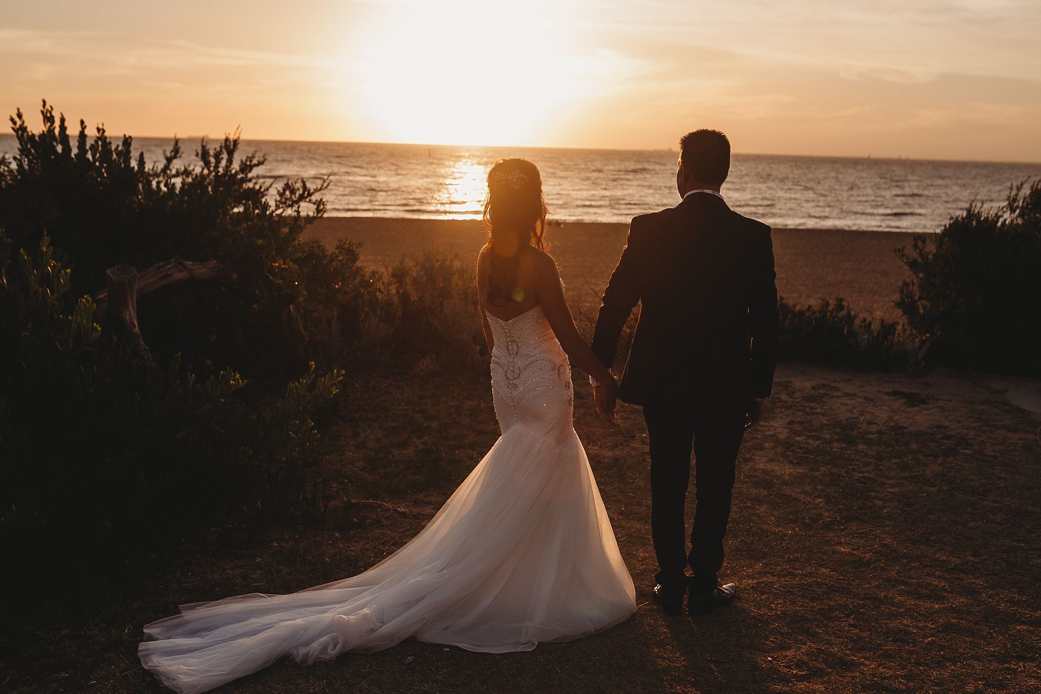 wedding photo at sunset at brighton beach