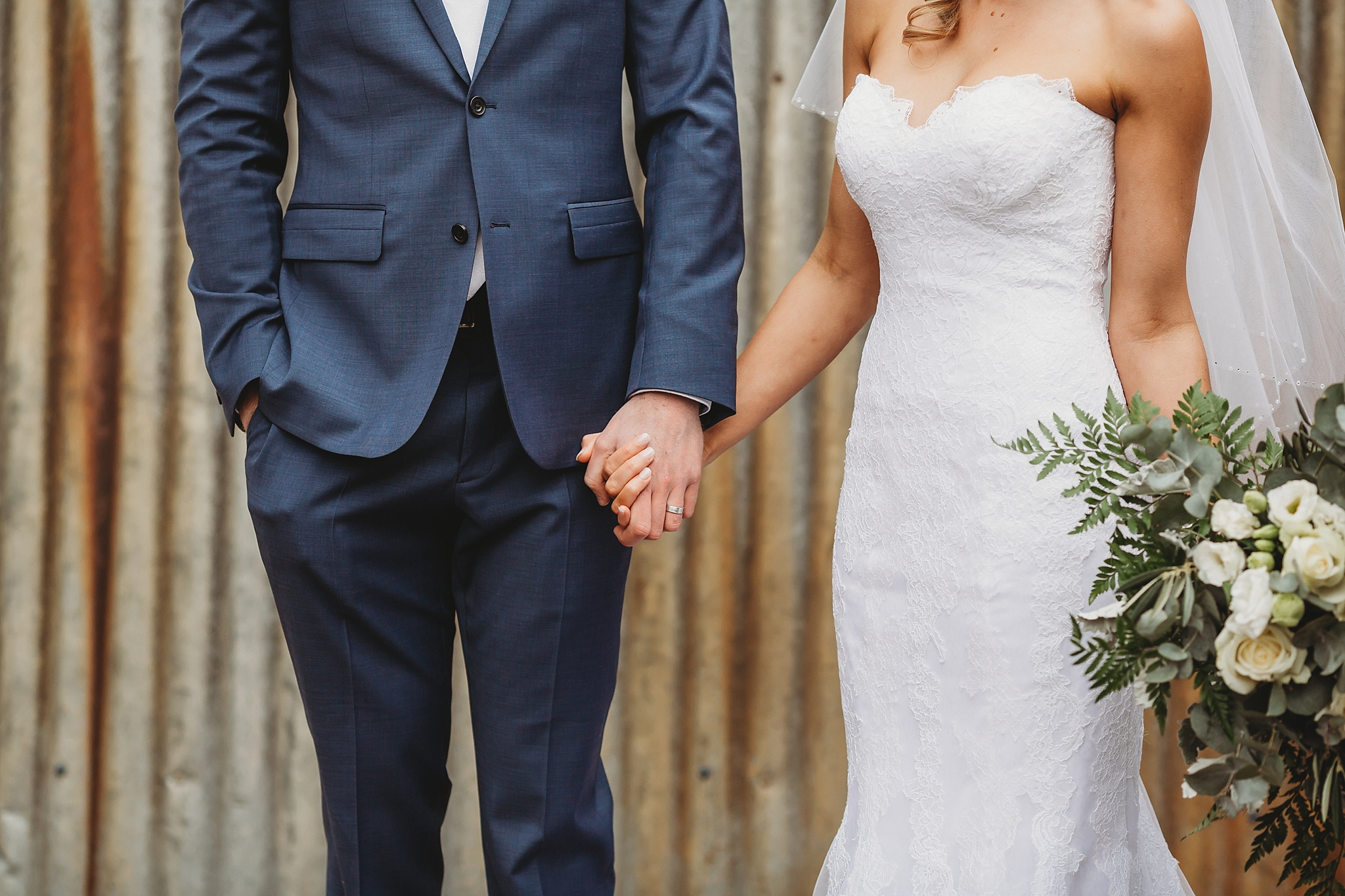 bride and groom hanging on hands