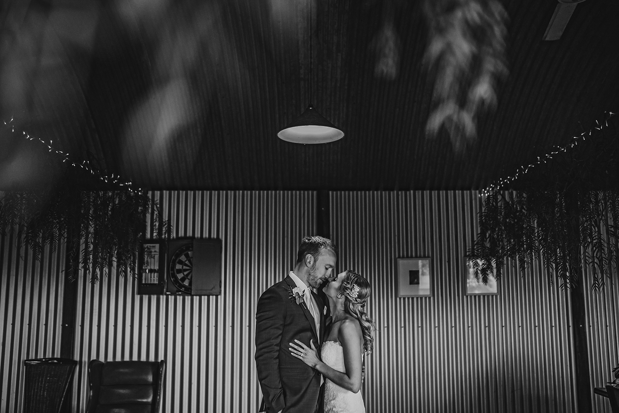 bride and groom in kissing pose