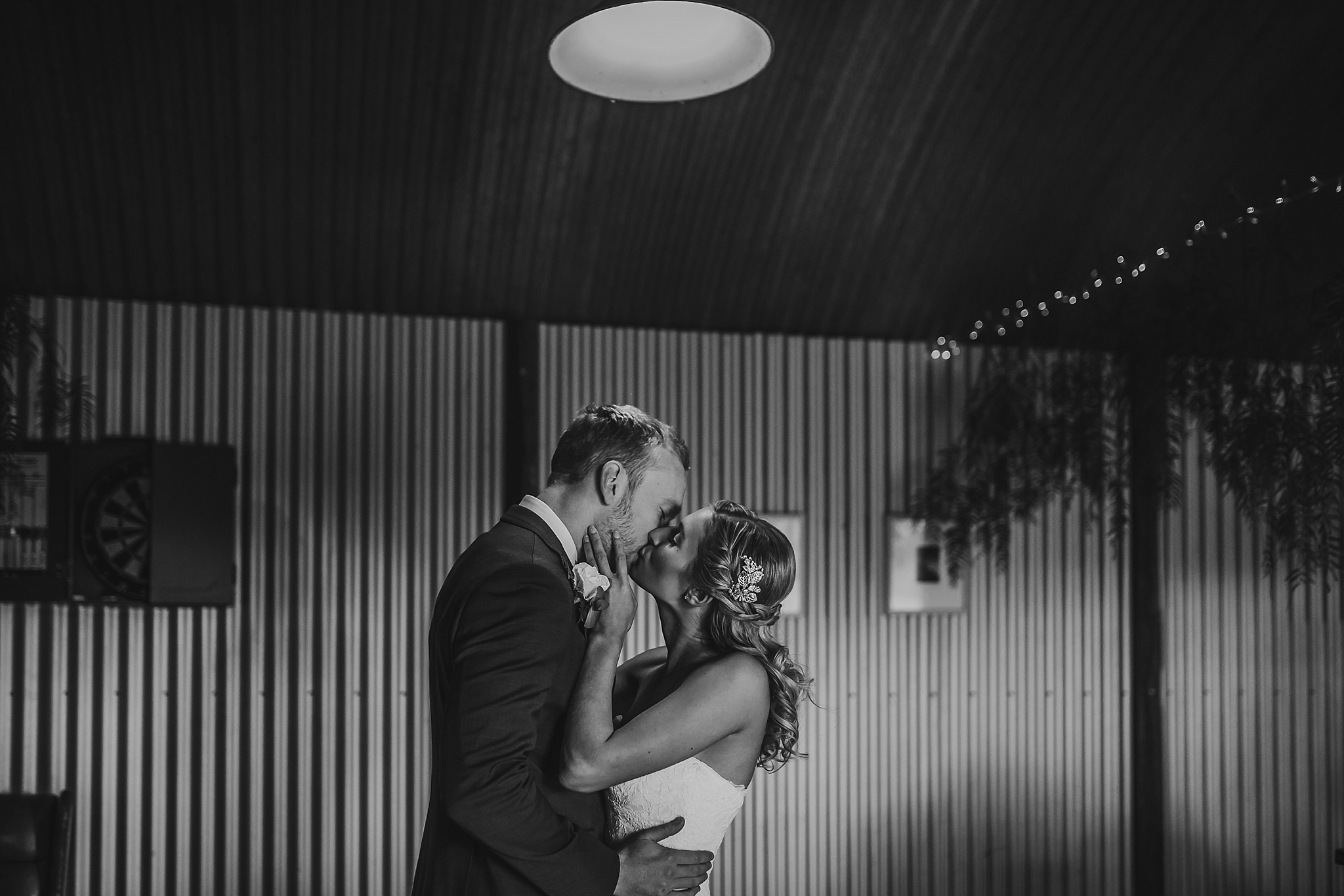 bride and groom kissing close