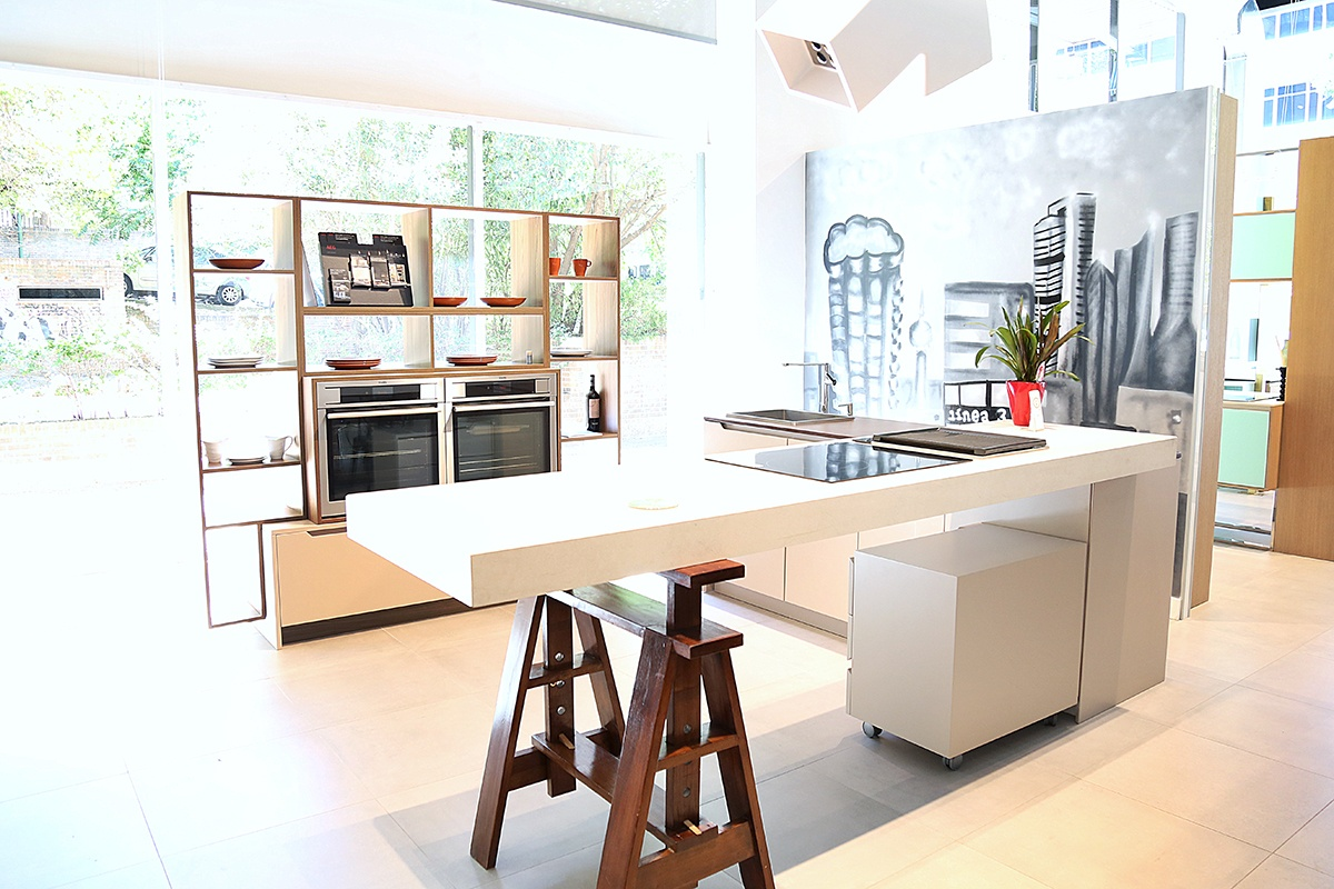 Sleek and modern style kitchen with a splash of rustic industrial introducing the trestle legs.