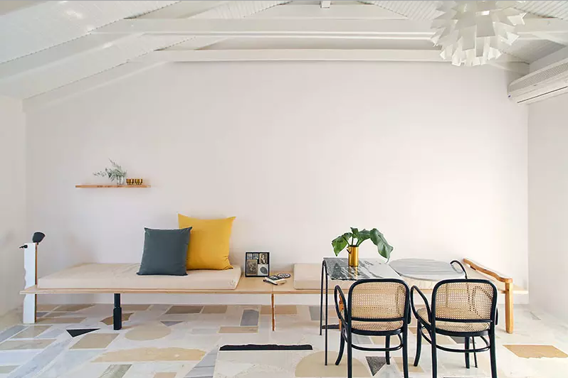 Oversized pieces and muted colours in the flooring make a subtle impact.