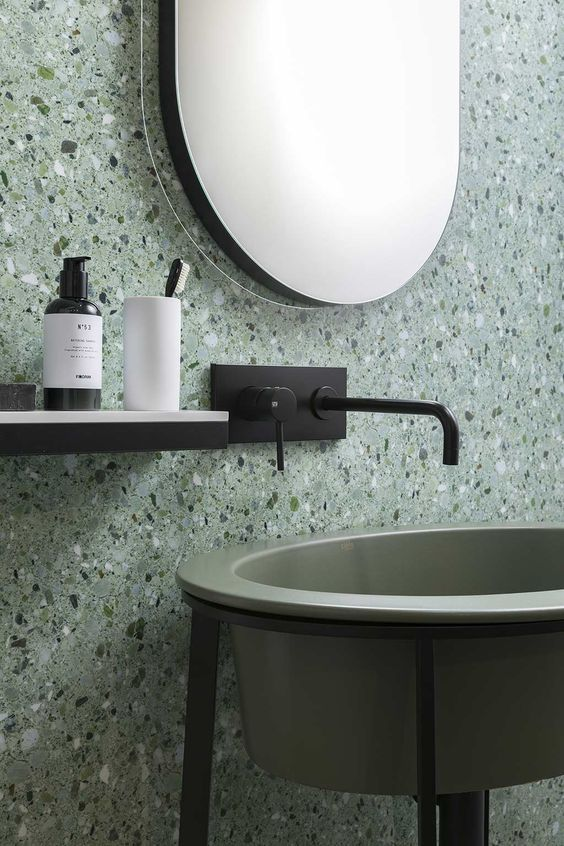 Natural green tones make for a calming bathroom vibe with the terazzo wall feature