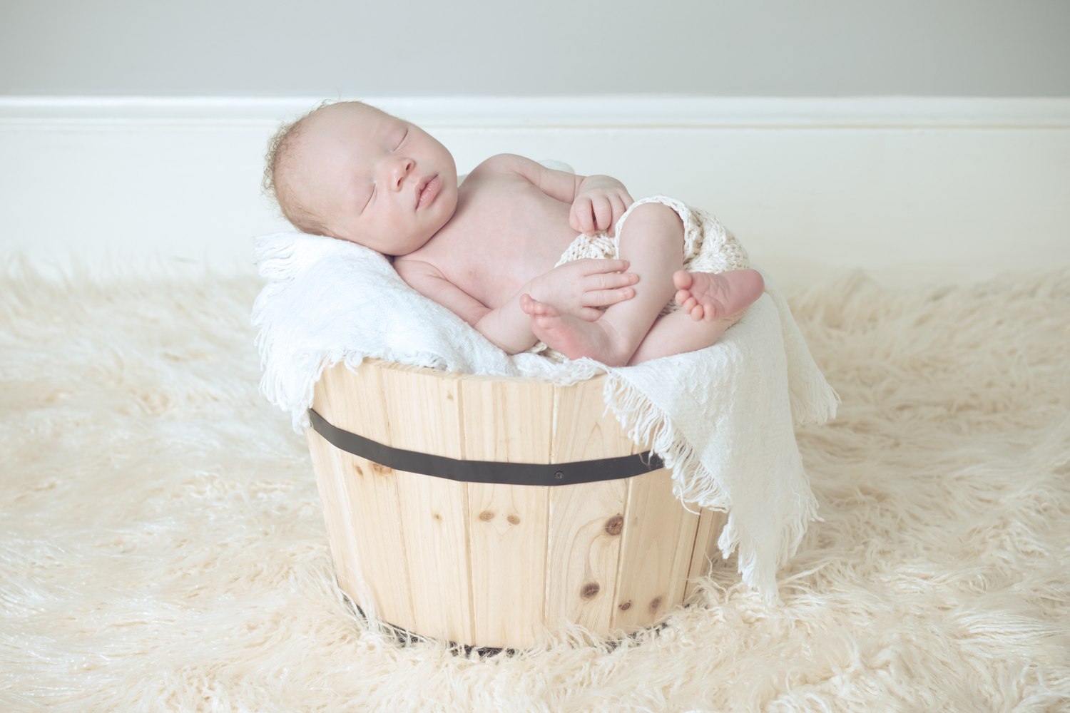 baby in a bucket