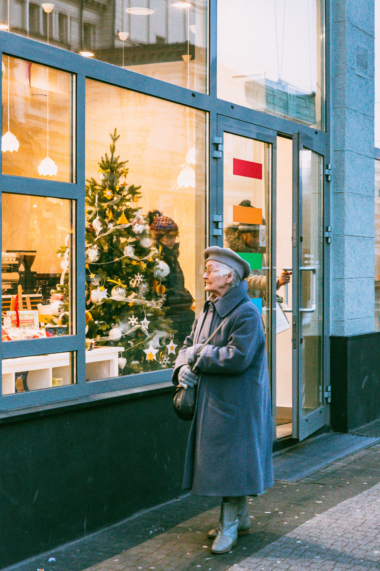 Old woman craving Christmas in Poznan