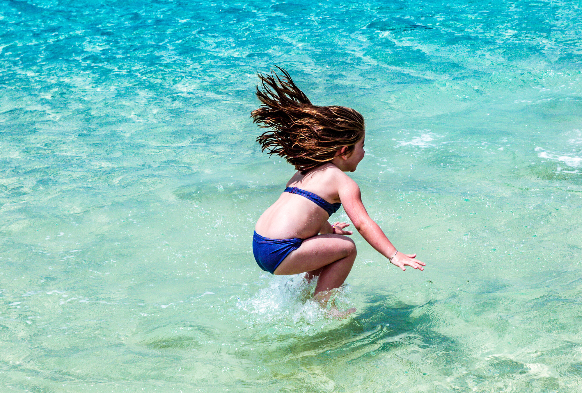 kids delight in leaping into the sea