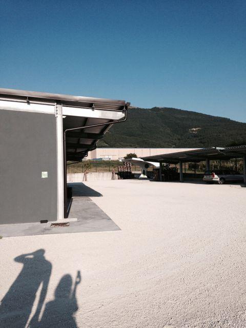 Rocchetta Bottling facility behind solar paneled powered Flea Brewery.jpg