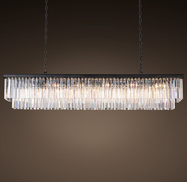 This elegant chandelier will demand the attention of the room and create the elegant, luxurious focal point in your space to set the stage for your masterpiece.   1920S ODEON CLEAR GLASS FRINGE RECTANGULAR CHANDELIER