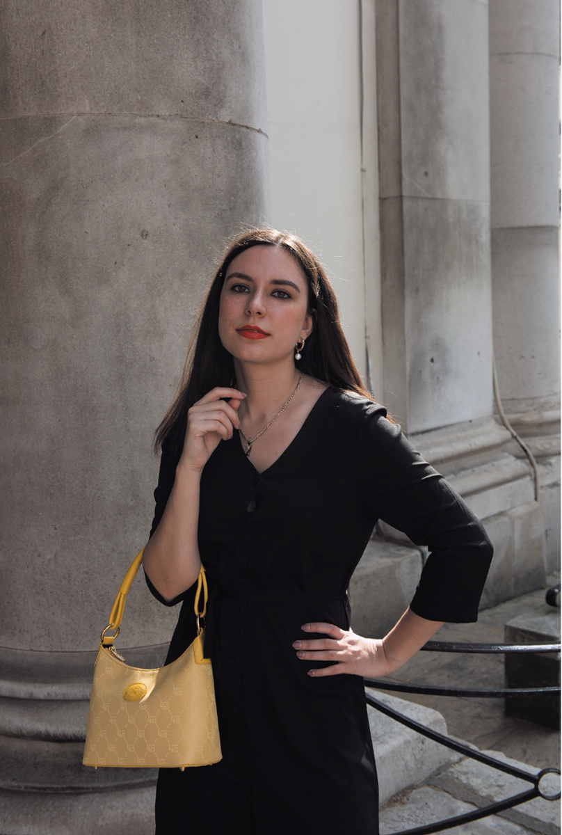 black shirtdress outfit with yellow bag