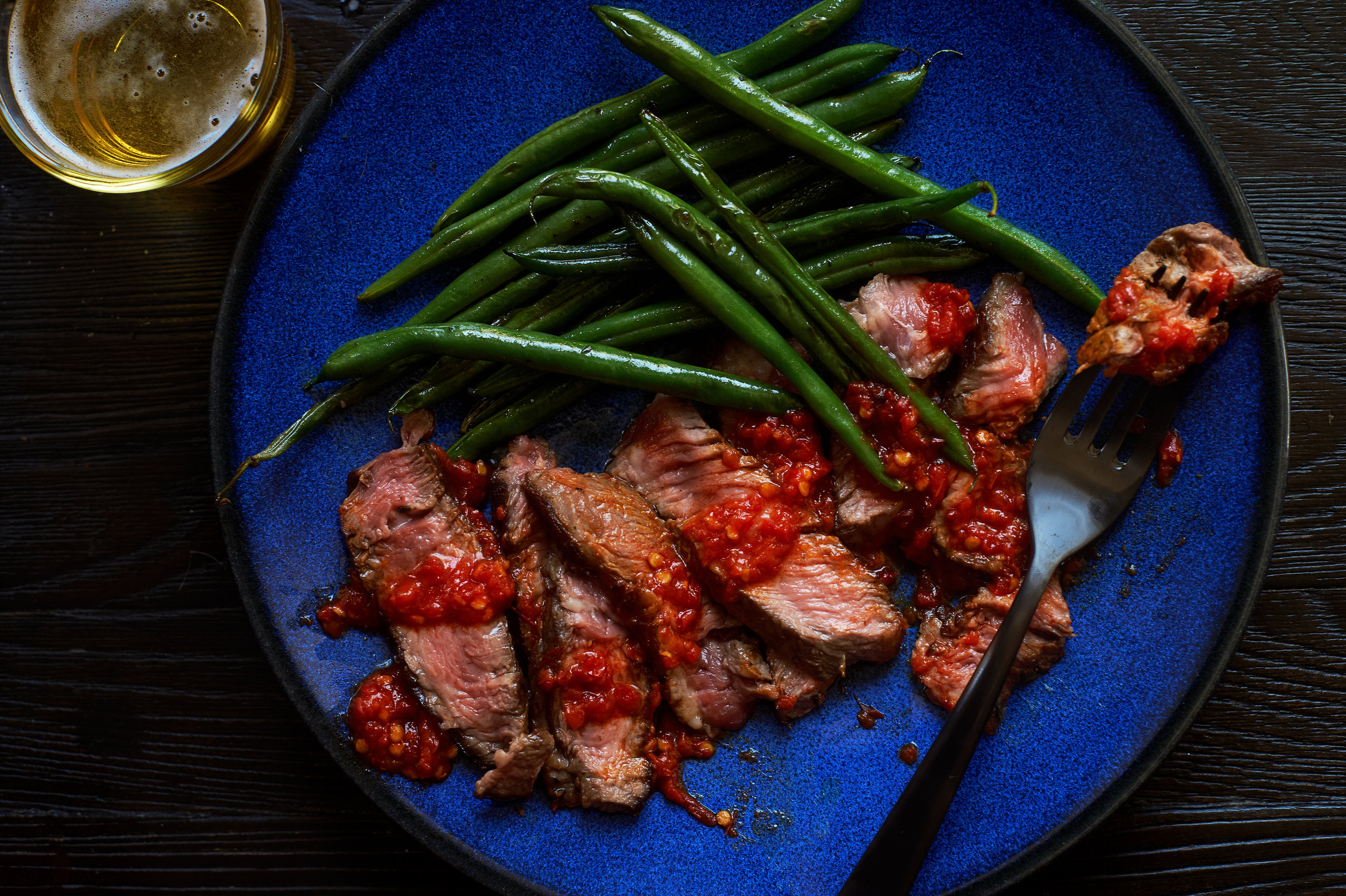 """Marinated Steaks : we bathe select cuts of steak, like skirt steaks, in our """"famous,"""" made-from- scratch Italian Style marinate with lemon, wine, oil & spices, which we love pairing with a luscious Burgundy after searing on the grill."""