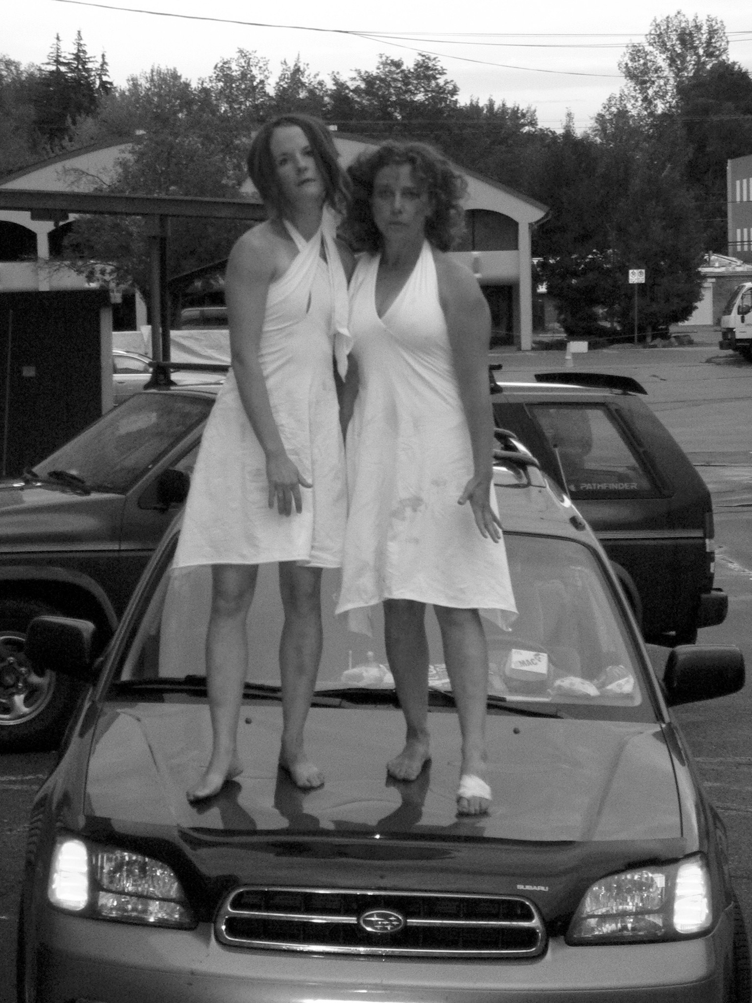 """Under the Hood - A Site-Specific work that takes place on a 2001 Subaru Outback created and performed by Breanna Rogers and Joanna RotkinThe Boulder International Fringe Festival,2007: Under The Hood wins """"Pick of The Fringe"""" for most innovative performance.photo by Glen Kalen 2008"""