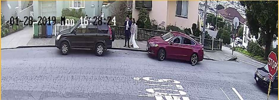 Surveillance video shows a bride and groom standing next to their burglarized rental car on Jan. 28, 2019 near the tiled steps at 16th Avenue and Moraga Street. The newlyweds were visiting San Francisco from Asia.