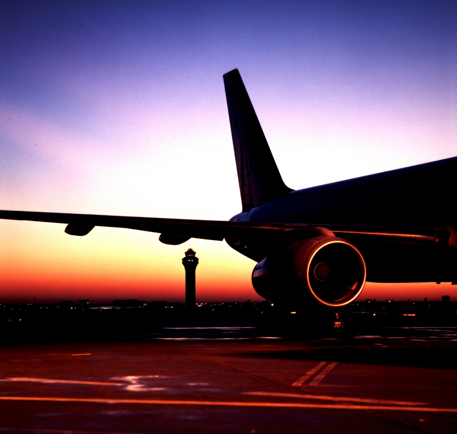 airplane-wing-with-sunset-and-tower1.jpg