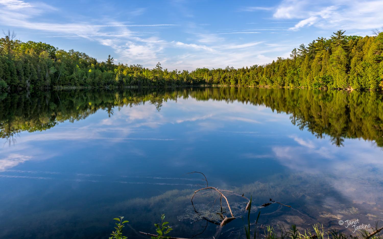 Reflecting-at-Crawford-Lake_Photo_copyright_Janet_Jardine.jpg