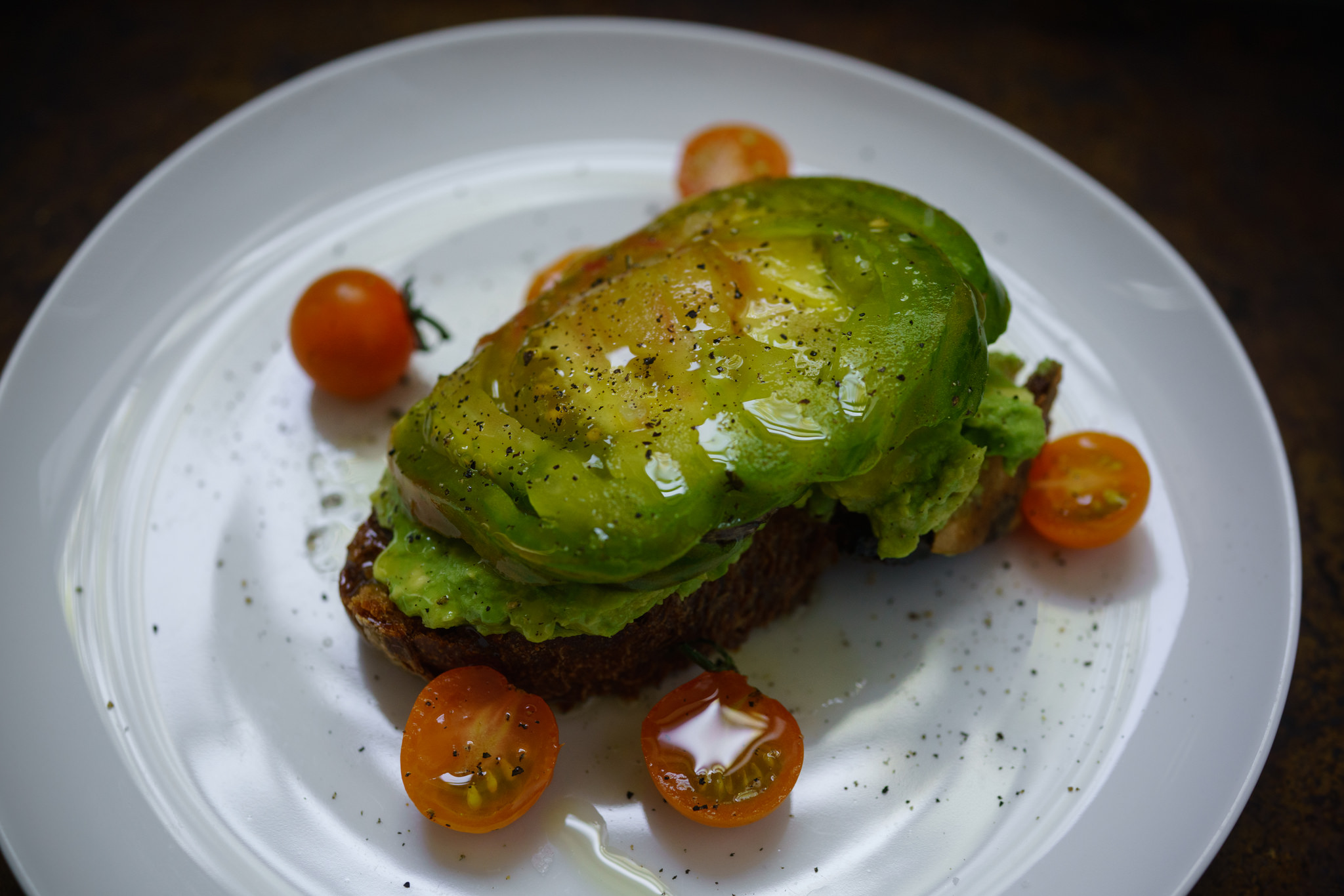 Avocado Toast with Heirloom Tomatoes for breakfast, at home in Brooklyn
