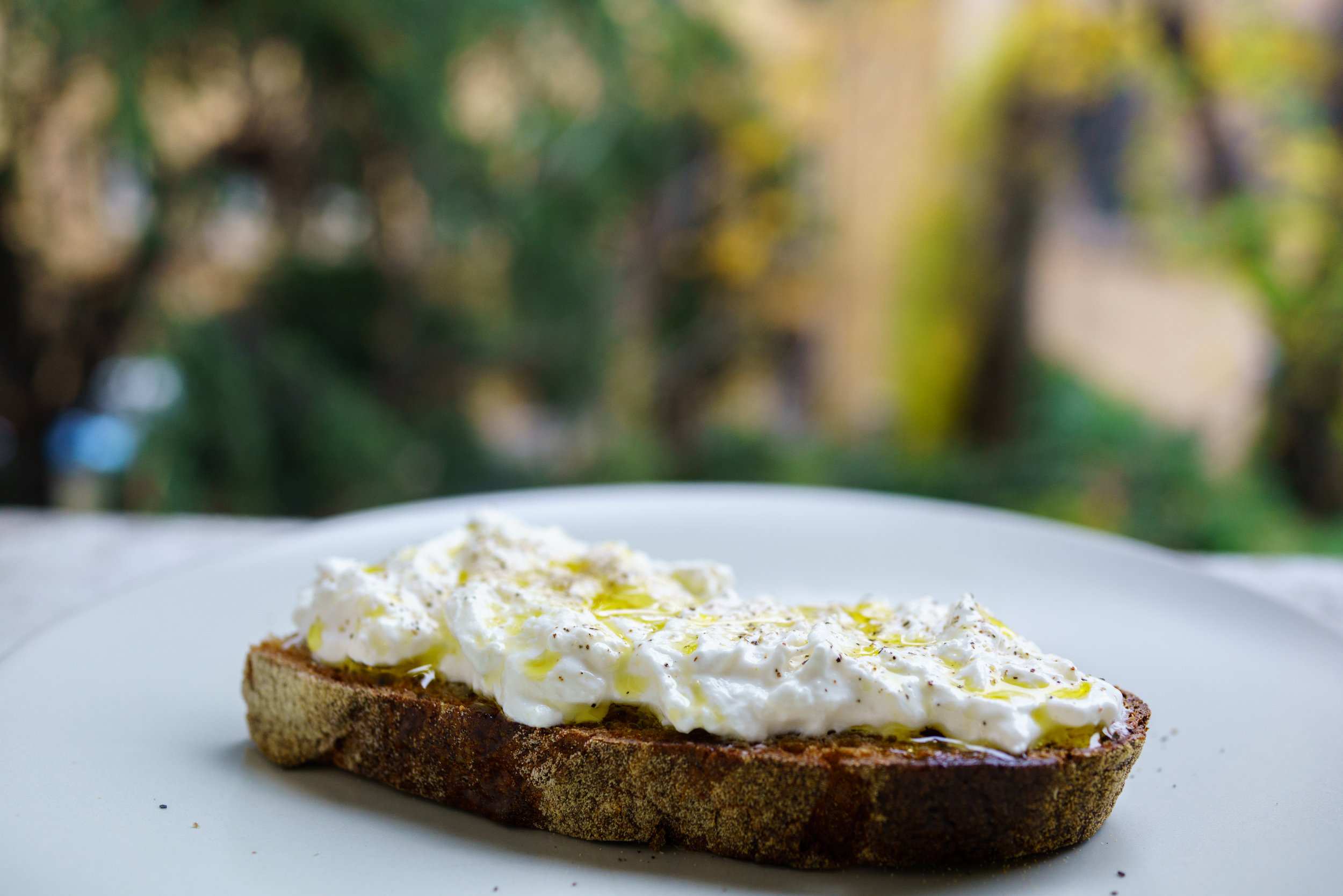 Sourdough topped with Stracciatella, drizzled with EVOO and finished with fresh cracked pepper
