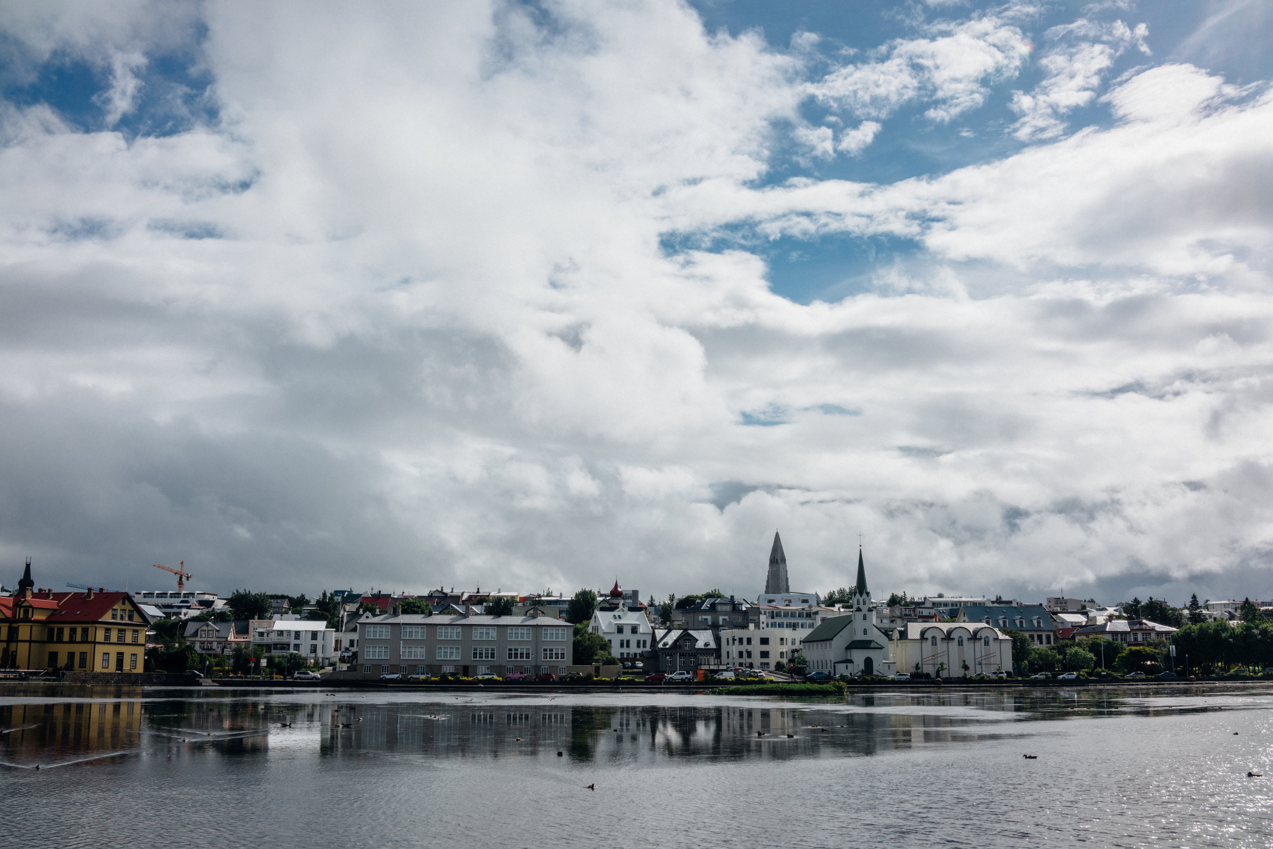 Looking across at Reykjavík through Reykjavíkurtjörn, not far from  Alþingishúsið ,or Althing, Iceland's national parliament, also the oldest legislature in the world that still exists.