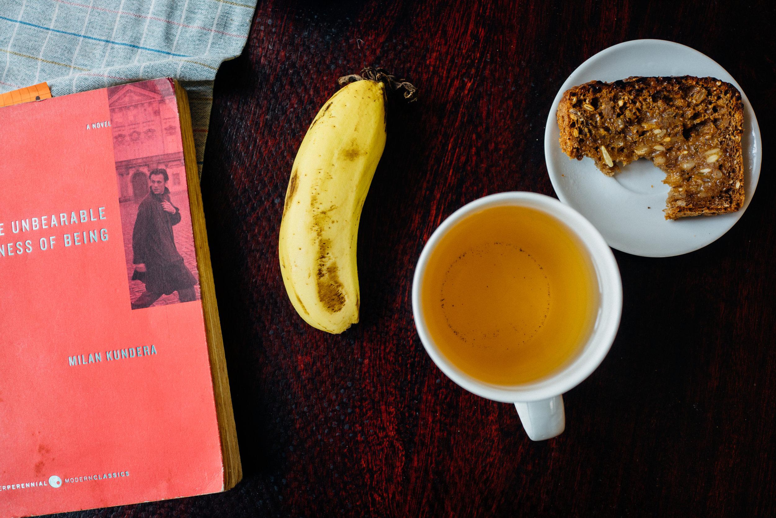 A Sunday breakfast for Mela: banana, dense rye bread with butter, green tea