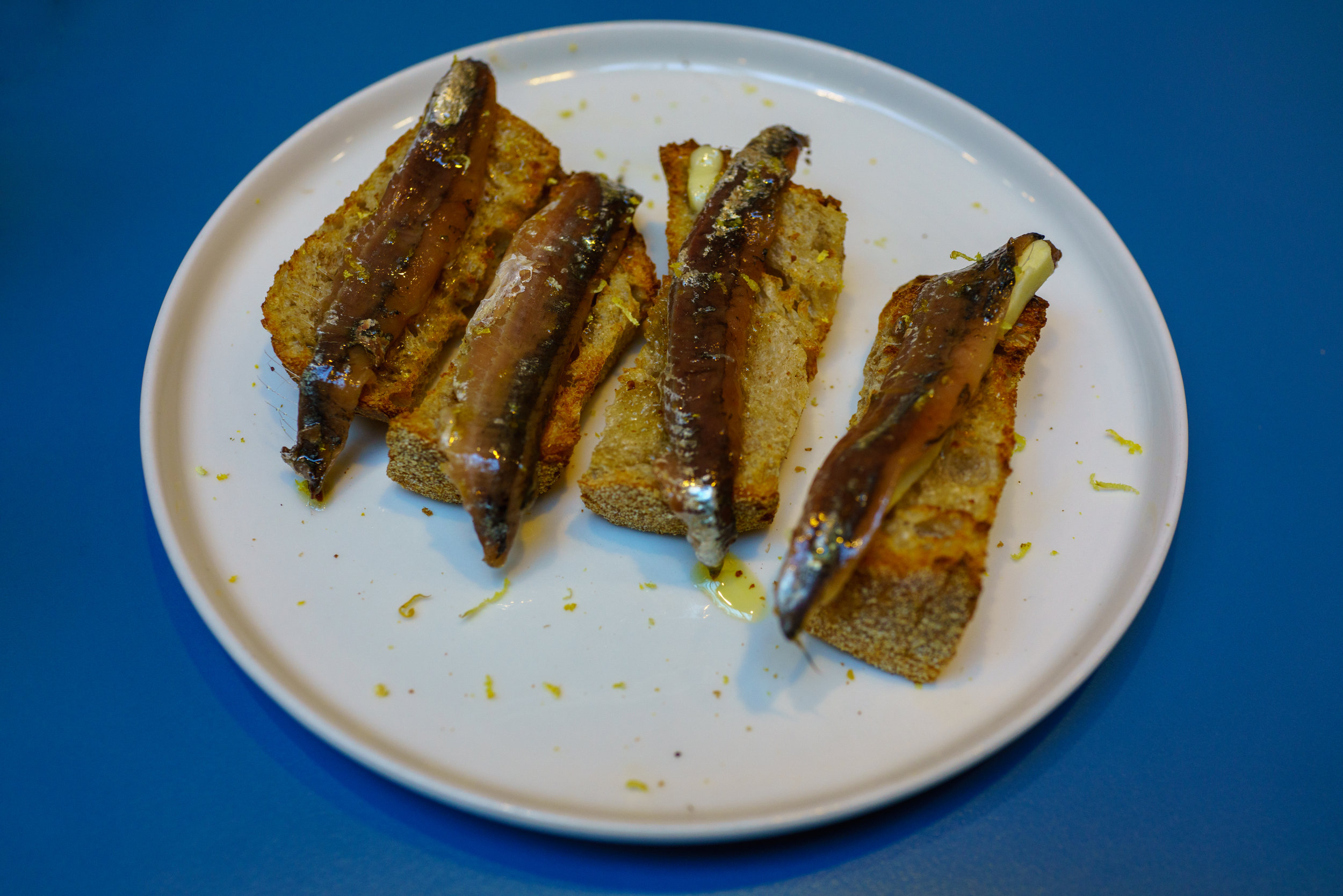 Crostini with Cetara Anchovies, Butter and Lemon Zest, Berberè Pizza, Bologna, Italy