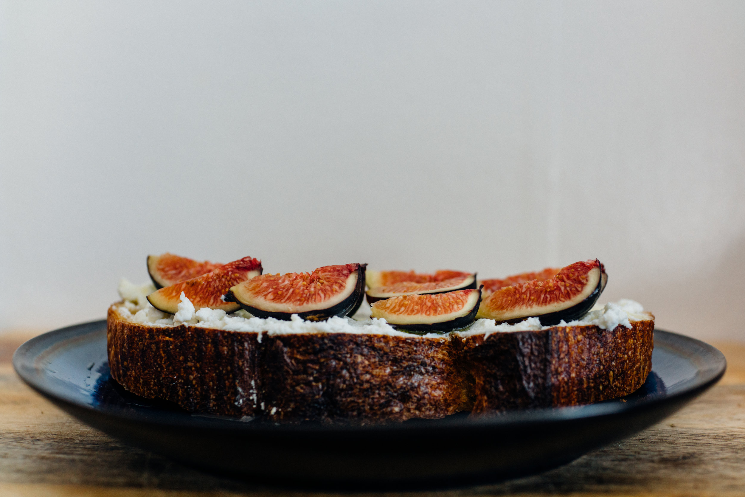 Josey Baker's country load with Ricotta, Local Figs, finished with Extra Virgin Olive Oil