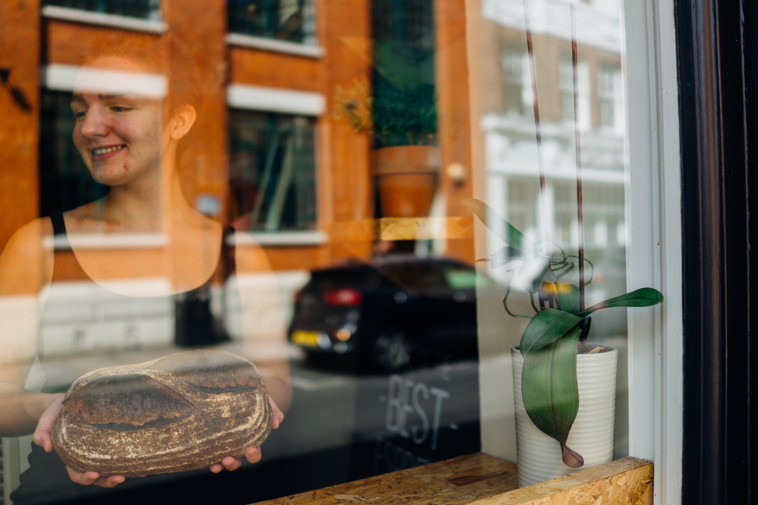 Alice Lyzcia with Little Bread Pedlar's Brown Sourdough in London, UK