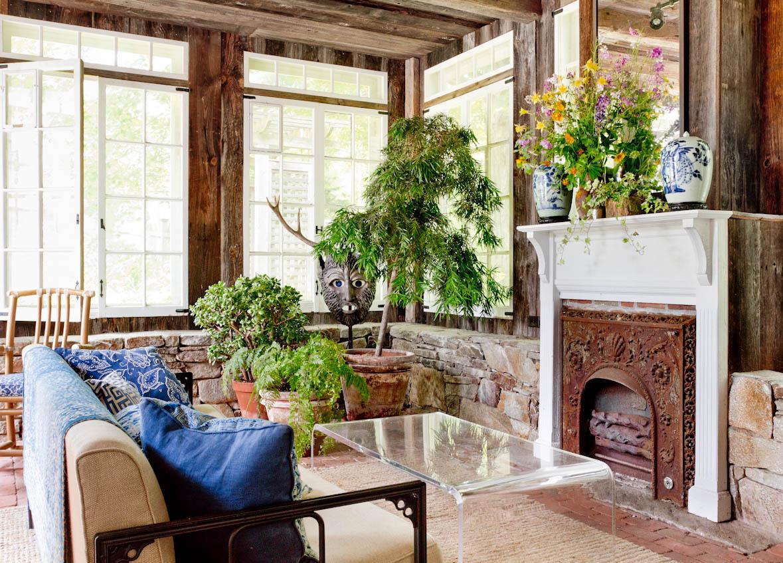 rustic-connecticut-farmhouse-porch-fireplace.jpg