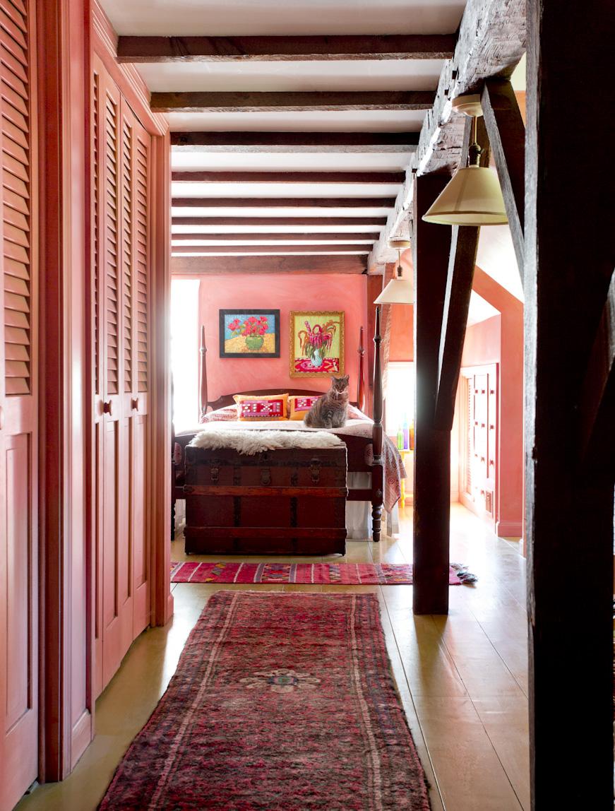 pink-bedroom-kitten-wood-beams-interior-photography.jpg