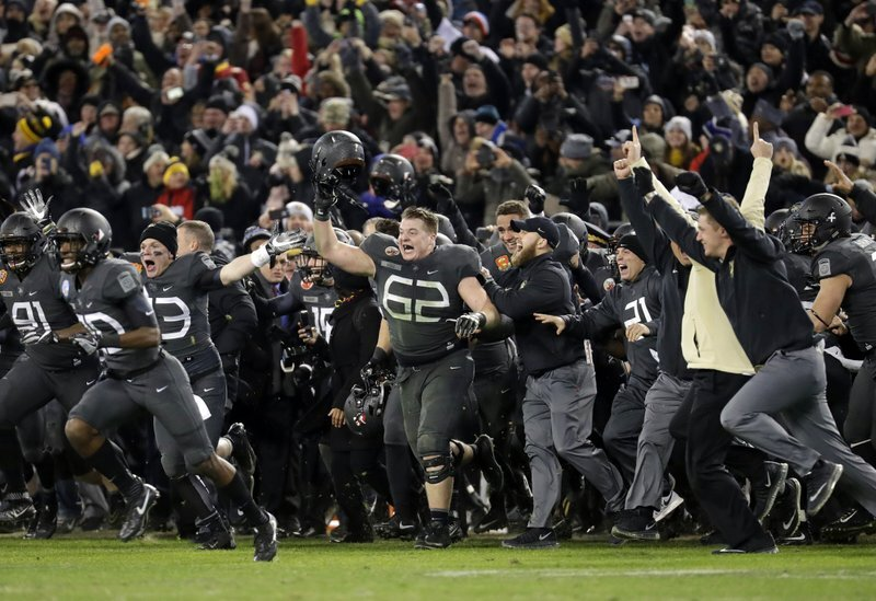 The Army sideline reacts to defeating Navy, many remembering the sign I had written.