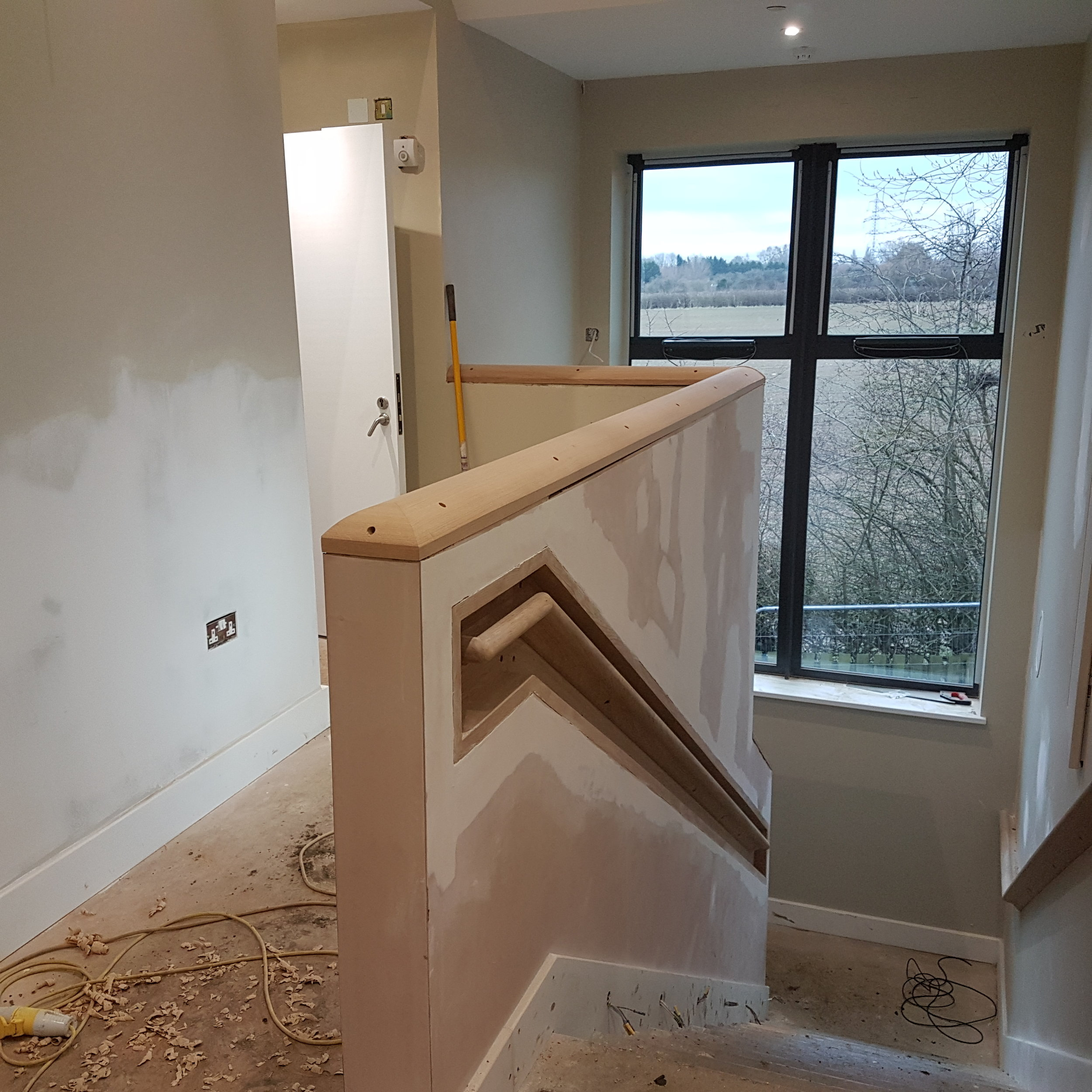 Inset oak handrail and capping at a school in standlake