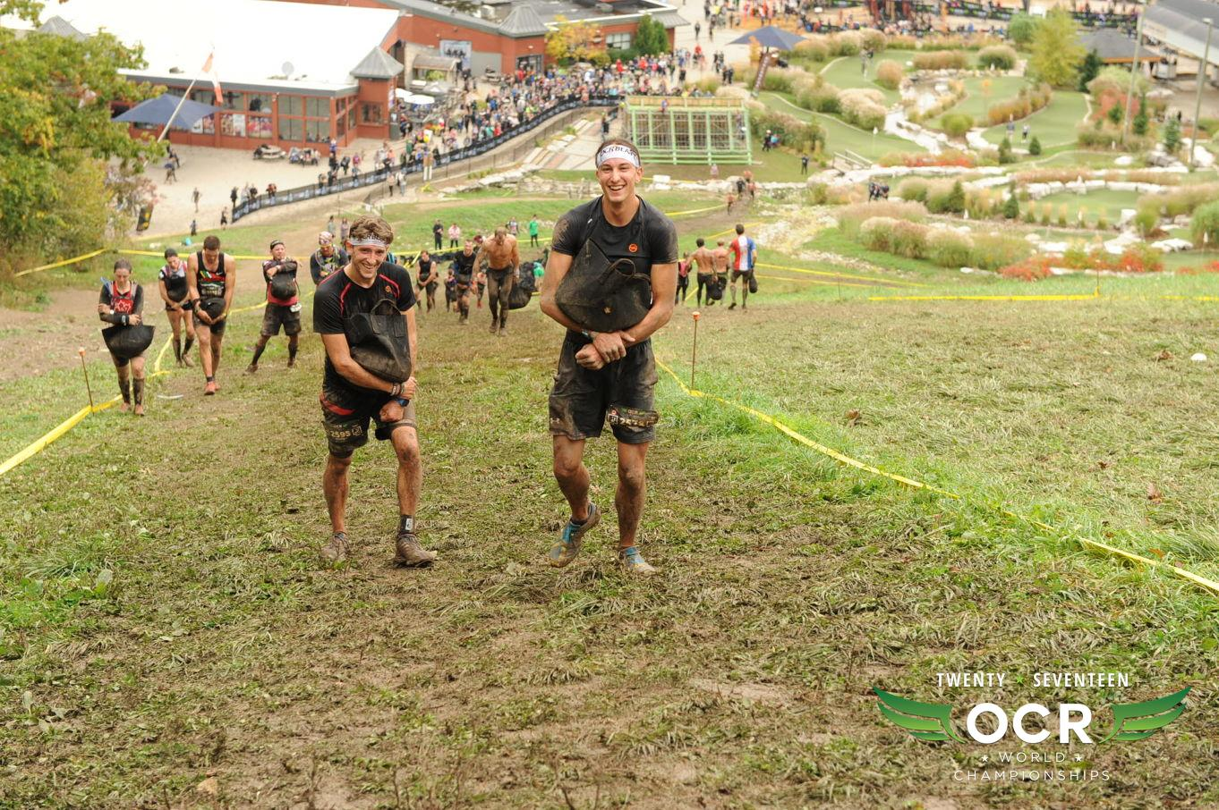 Here's Kirk and I carrying a sandbag at the same time, over an hour into the race (and laughing about it).