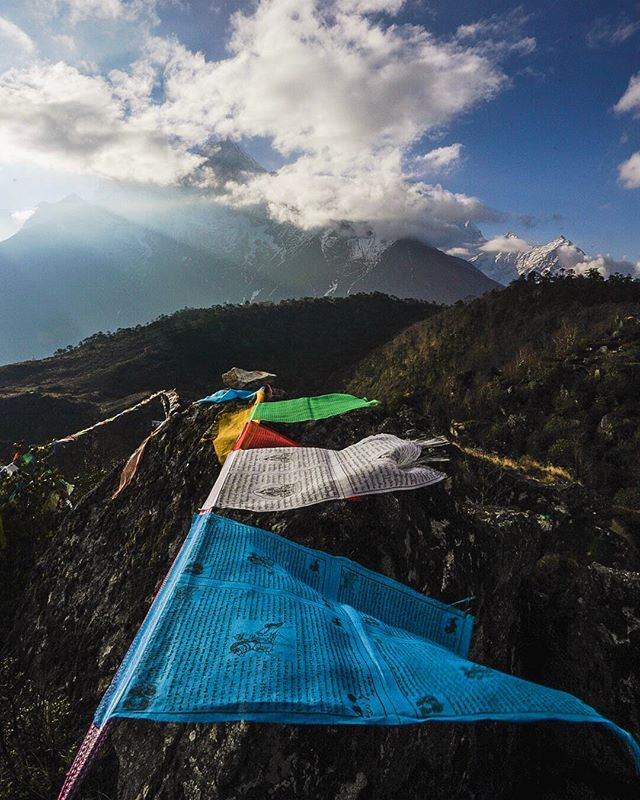 Prayer flags wave in the early morning light with Thamserku rising into the clouds in the distance. The first 10 days in Nepal have been nothing short of spectacular, what a beautiful country.