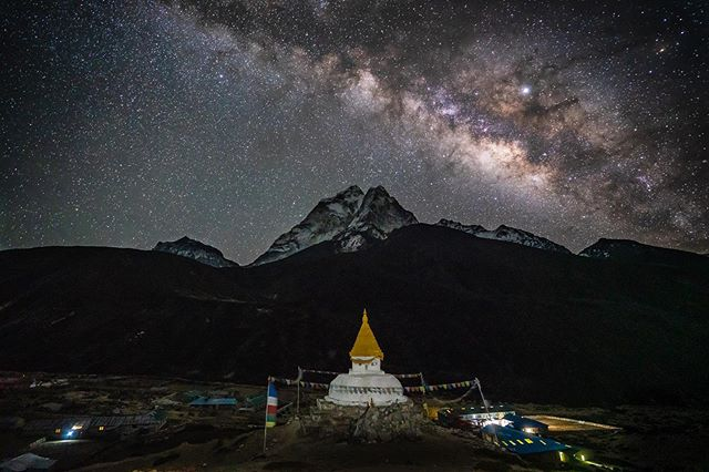 The village of Dingboche's stupa sitting at 14,500 feet with the Milky Way rising over Ama Dablam in the background 🏔✨