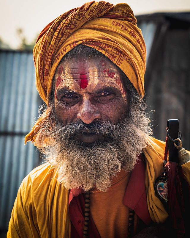 One of the sadhu's of Pashupatinath Temple in Kathmandu. The sadhu's of #Pashupatinath are said to be Holy men who've dedicated their lives to the Hindu Supreme Lord #Shiva. However, as holy as they may look, during our time at the temple it was tough to see the #sadhus as much more than beautifully dressed beggars, as they continued to hound my clearly tourist looking self for rupee donations. This one succeeded, but at least he let me take his photo. #sadhu