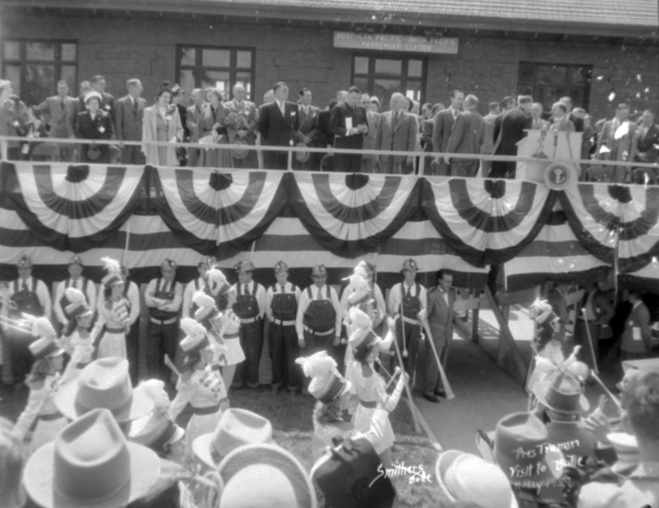 President Harry S. Truman stands at the front of the Depot ready to address a crowd of spectators. Photo 32-080-04_C. Owen Smith courtesy of Butte-Silver Bow Public Archives