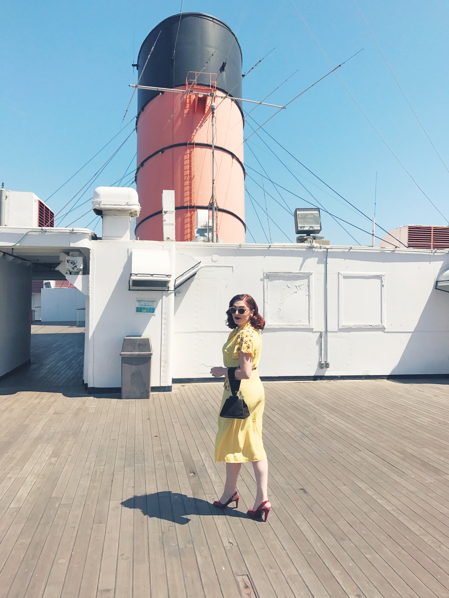 Aboard the deck of the Queen Mary  Photo via  Finding Lost Angeles  (2017)