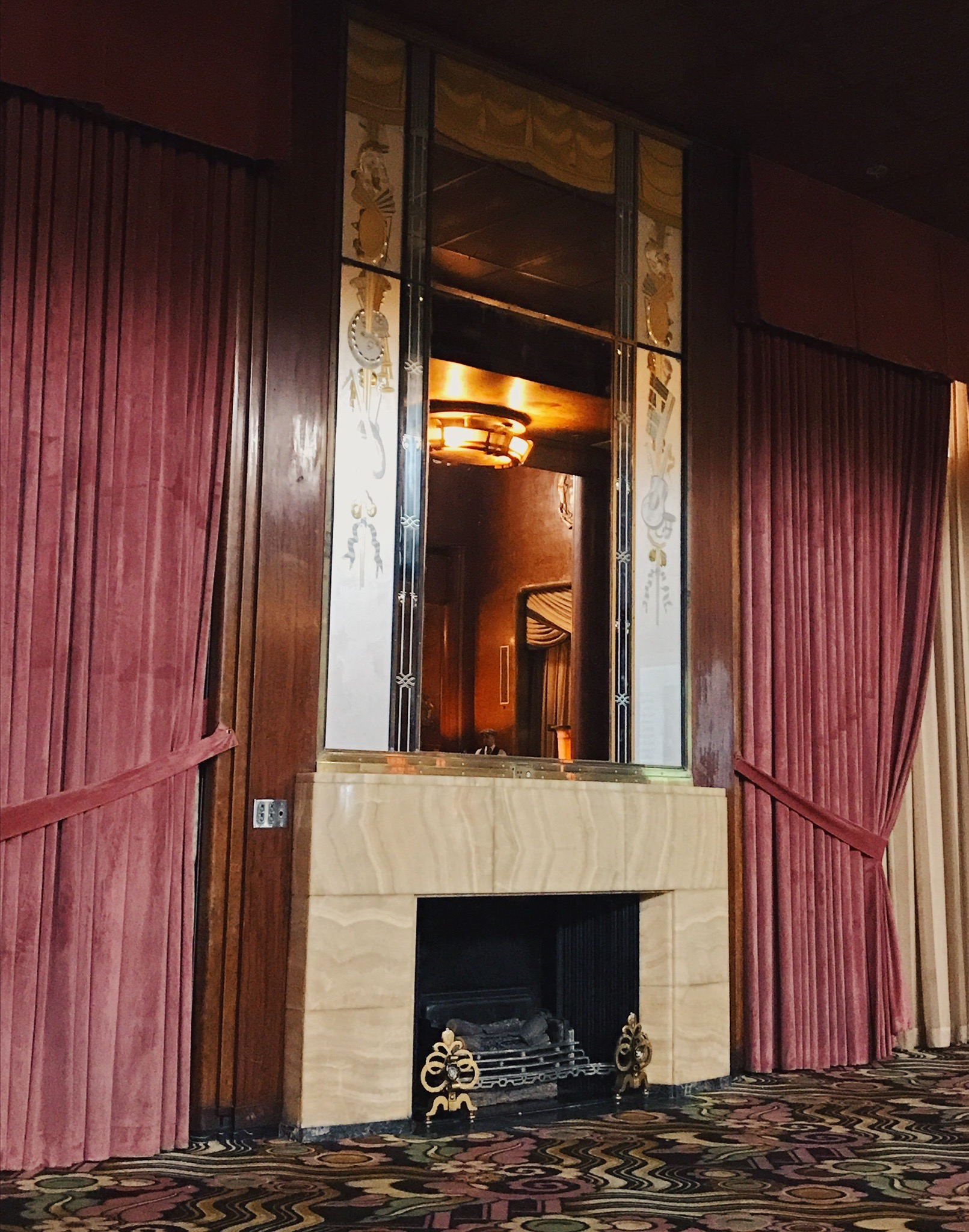 Art deco fireplace in the Queen Mary First Class Lounge  Photo via  Finding Lost Angeles  (2017)
