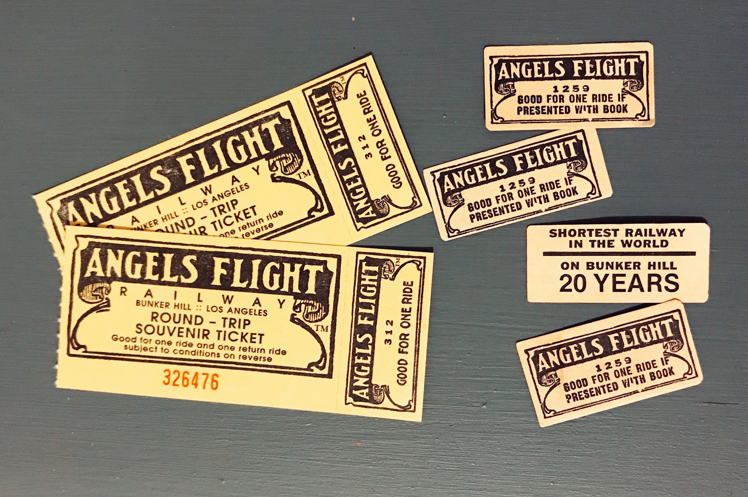 Angels Flight 2017 souvenir tickets (left) and 1921 tickets (right)  Photo via  Finding Lost Angeles  (2017)