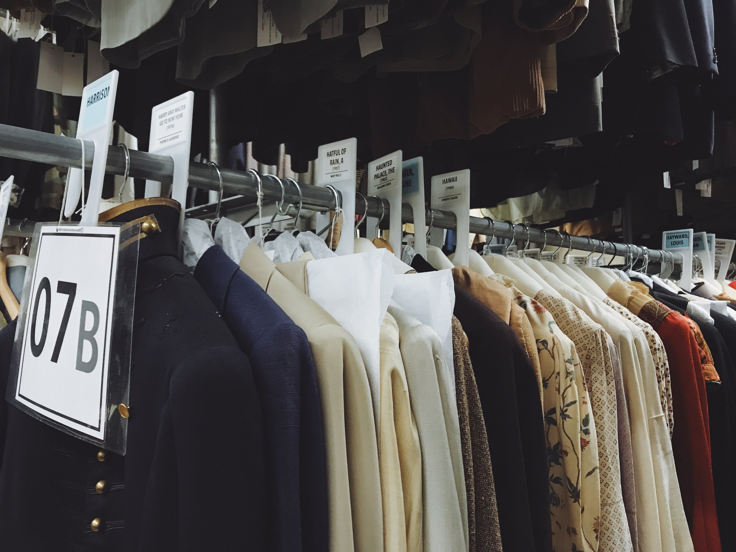 Some of the racks in Western Costume's historical archive, carefully categorized by performer and film.  Photo via  Finding Lost Angeles (2018).