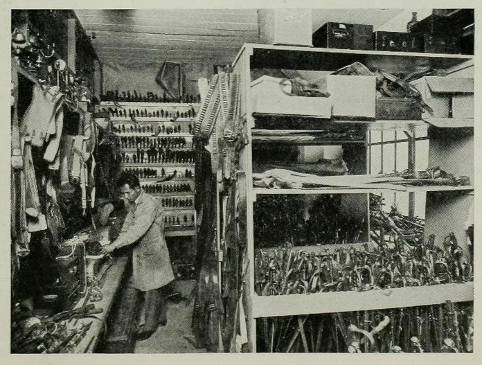 Collection of swords and other weaponry at Western Costume in the early 20th Century.  Photo via  Photoplay  (Feb. 1928).