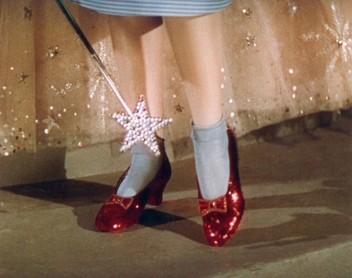 The final product of costume designer Gilbert Adrian and Western Costume Company, Dorothy's ruby slippers on screen in  The Wizard of Oz  (1939).  Photo via  Metro-Goldwyn-Mayer .