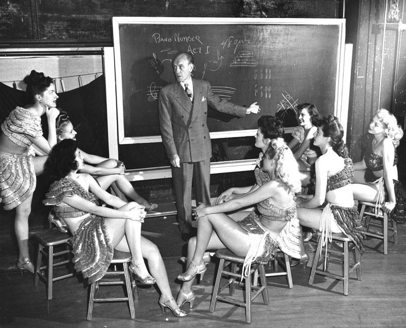 Carroll planning his show with the chorus girls. Photo via Los Angeles Public Library (date unknown) .