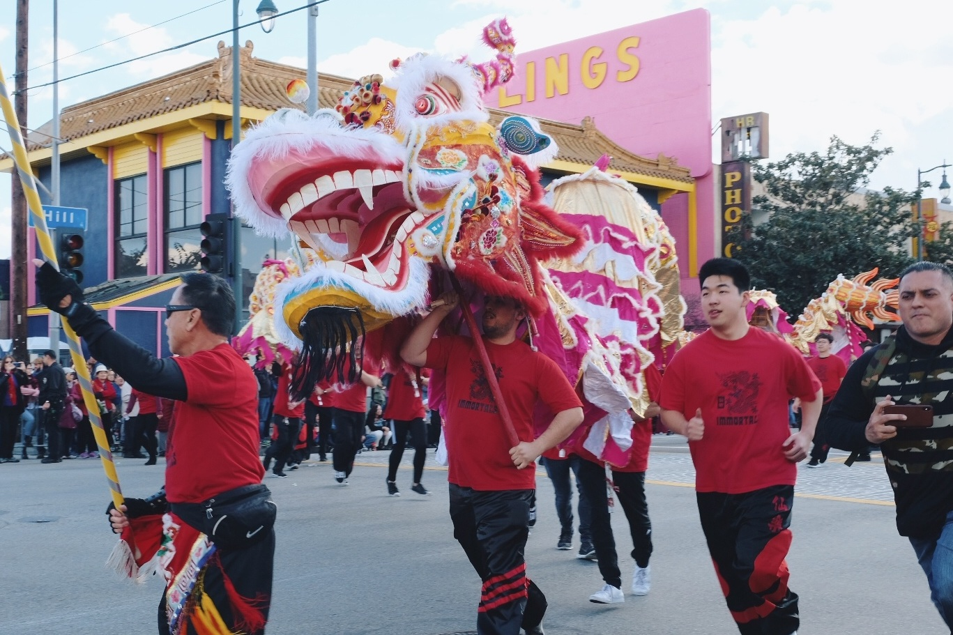 Dragon running down the street in the Chinatown Parade 2019