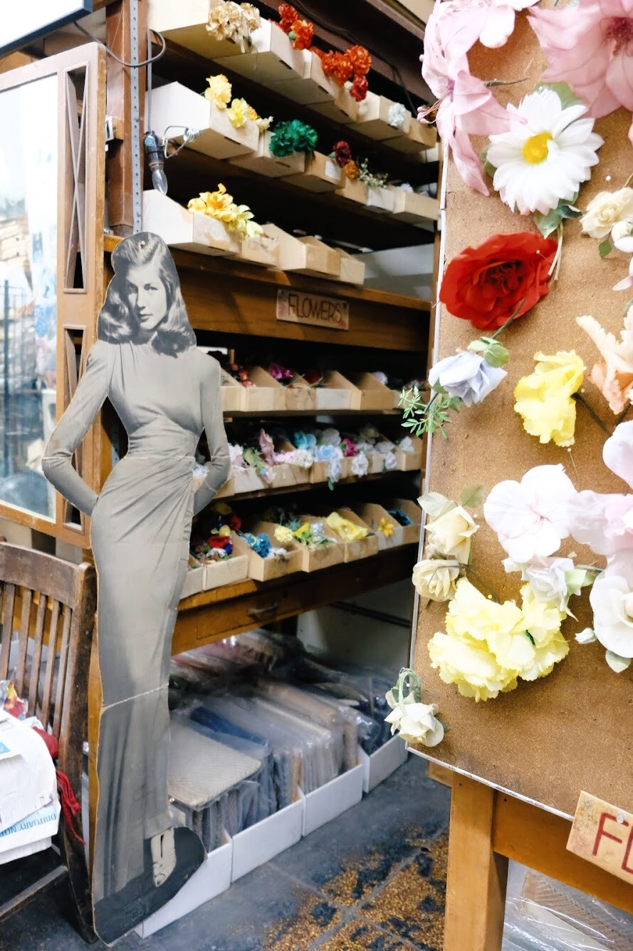 Lauren Bacall hanging out amongst the flower trimmings at California Millinery. (2019)