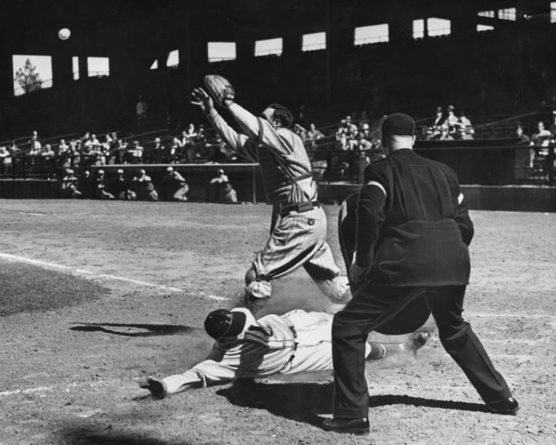 "Arnold ""Jigger"" Statz of the Los Angeles Angels slides home to score against the Portland Beavers on April 16, 1937. Image via LA Public Library, Los Angeles Herald Examiner Collection."