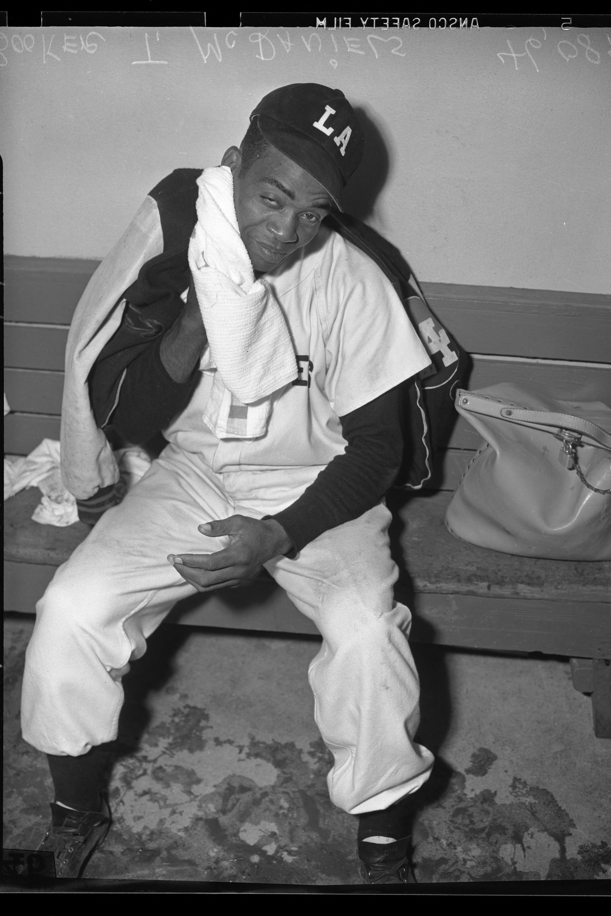 While Jackie Robinson broke baseball's color barrier with the Brooklyn Dodgers on the east coast in 1947, the Pacific Coast League also began to integrate that same year. Two years later, Booker McDaniels, pictured here, was signed as a pitcher for the Los Angeles Angels. Image via UCLA Library Special Collections (1949).