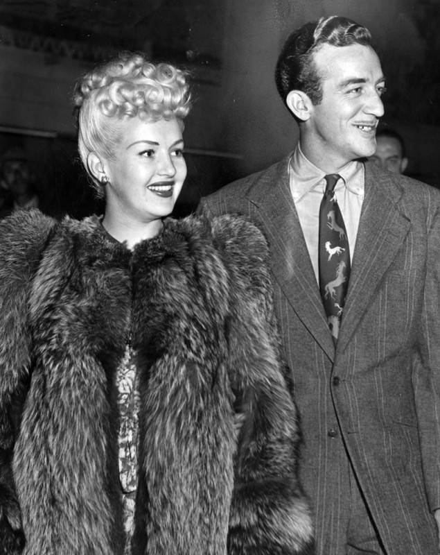 """Newlyweds Betty Grable and Harry James were among the stars of the entertainment world who were thrilled by the dazzling performances"" of the Ice Follies at the Pan-Pacific Auditorium. Photo via LA Public Library,  LA Herald Examiner  Collection (Sept. 24, 1943)."